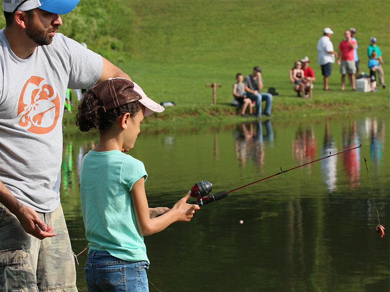 girl and man fishing at the Bella Vista Fishing derby