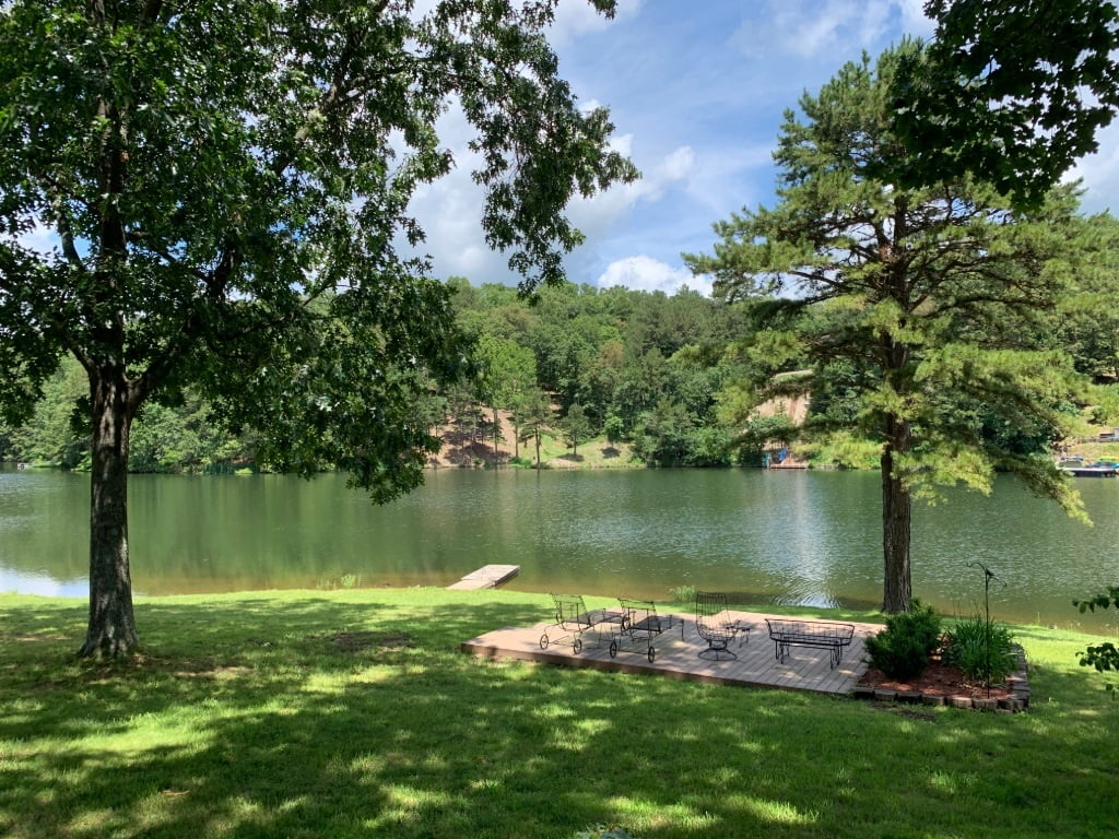 View of the amazing backyard and porch of Lake Rayburn vacation rental Unit 0224 in Bella Vista Arkansas.